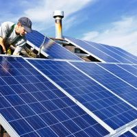 Man,Installing,Alternative,Energy,Photovoltaic,Solar,Panels,On,Roof
